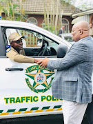 Superintendent Mbuso Biyela accepts a new traffic vehicle from Mayor Thelumoya Zulu. Biyela was shot dead with his service pistol on Friday afternoon.