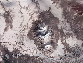 Photo: Detail view of Russia's Kamchatka Peninsula. This is a false-color satellite image, acquired by the Advanced Spaceborne Thermal Emission and Reflection Radiometer (ASTER) on March 10, 2010.To download a full high res version of this image and to learn more go to:http://earthobservatory.nasa.gov/NaturalHazards/view.php?id=43103Credit:NASA Earth Observatory image by Jesse Allen and Robert Simmon, based on data from the NASA/GSFC/METI/ERSDAC/JAROS, and U.S./Japan ASTER Science Team.Instrument: Terra - ASTERFor more information about the Goddard Space Flight Center go here:http://www.nasa.gov/centers/goddard/home/index.html