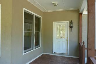 Photo: Door to garage from back deck.