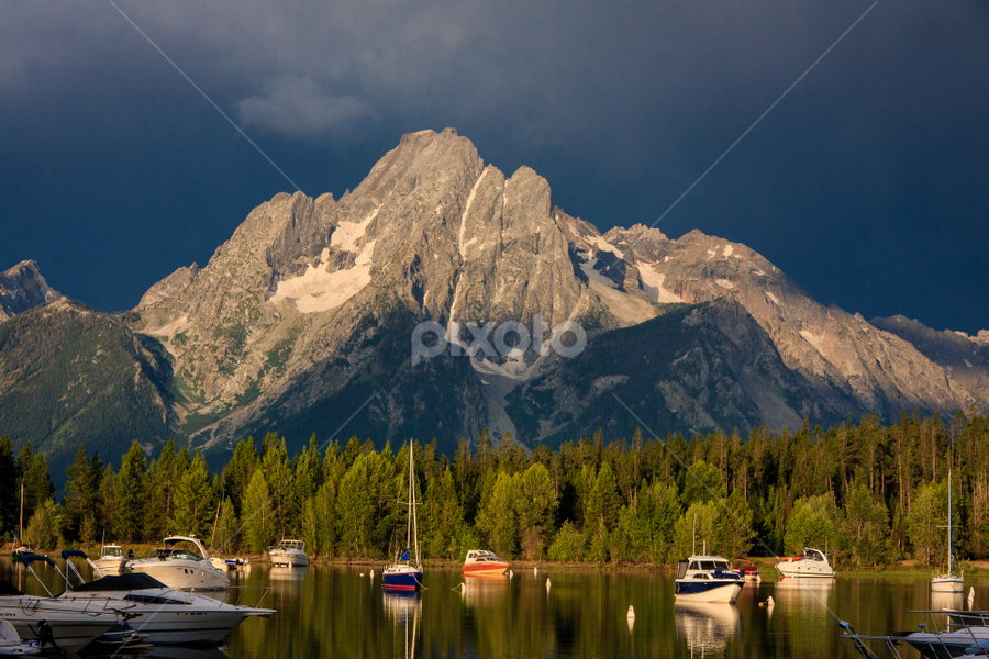 Calm before... by Paul Judy - Landscapes Mountains & Hills ( yellowstone, mountain, boats, lake, storm clouds )