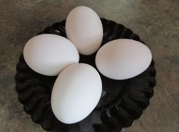 Boil eggs then remove from heat. Let cool, then peel and chop and add...