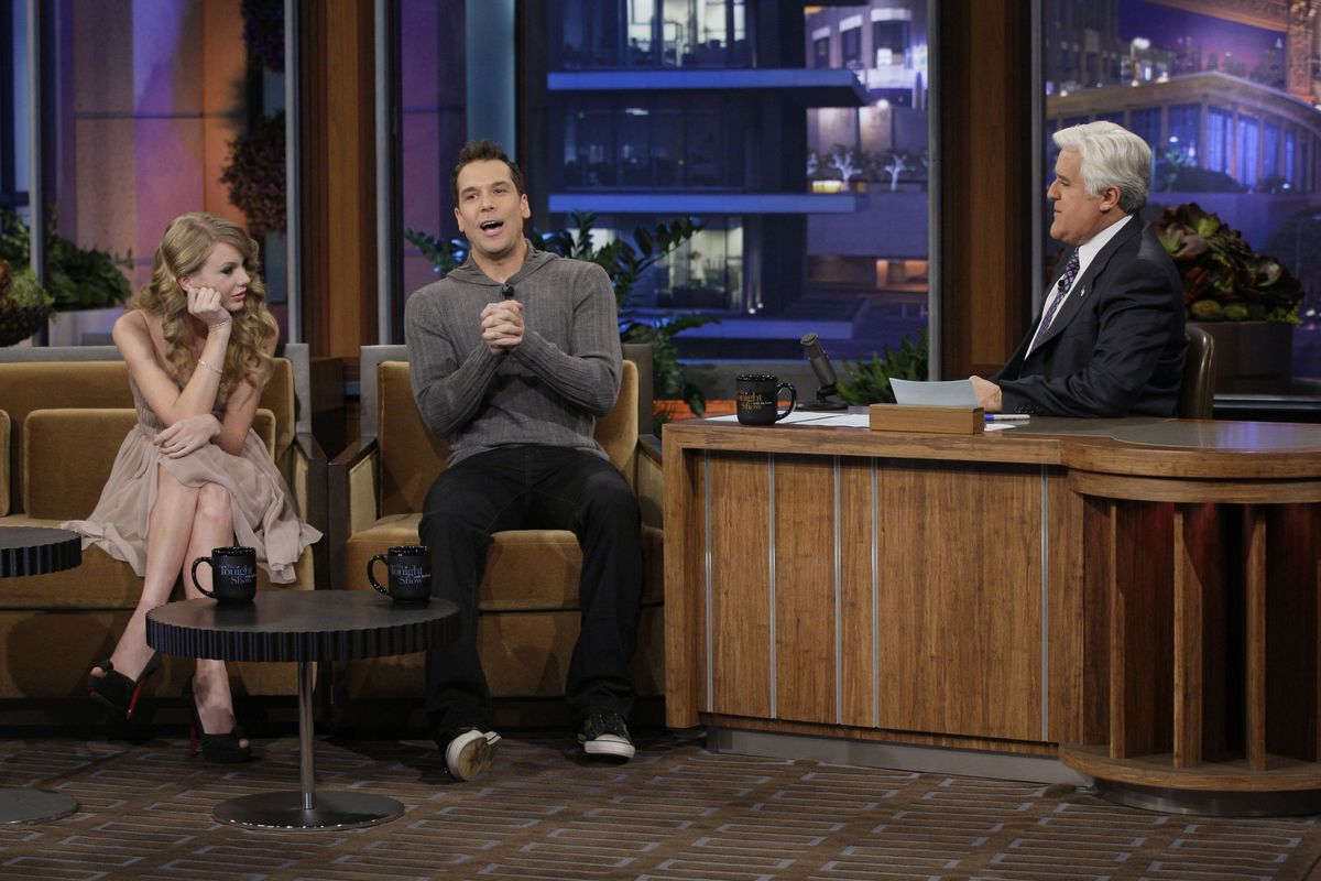 THE TONIGHT SHOW WITH JAY LENO -- Episode 3936 -- Pictured: (l-r) Singer Taylor Swift and comedian Dane Cook during an interview with host Jay Leno on November 22, 2010 (Photo by Paul Drinkwater/NBC/NBCU Photo Bank via Getty Images)