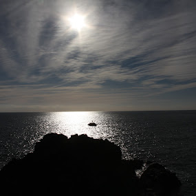 Sun over water by Tony Pitt - Landscapes Waterscapes ( water, silhouette, cloud, sea, coast, sun )