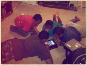 Photo: the kids playing tap tap revenge