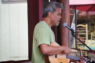 Photo: Ukelele player Dennis Garcia, serenading the customers at the Lava Java cafe.