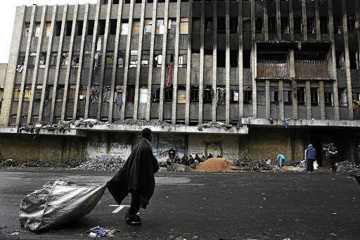No place to call home: People who had illegally occupied the Cape York building in central Johannesburg have been sleeping out in the cold since they were evacuated after a fire on July 5 killed seven people. Picture: ALON SKUY