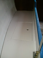 Photo: looking aft along pilot berth deck with fresh coat of paint