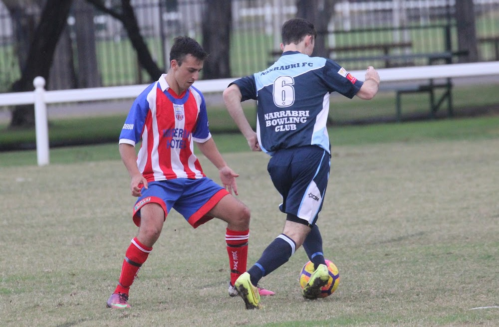 Wee Waa United's Jayden Hamblin stands up Narrabri FC's Jake Brayhsaw.