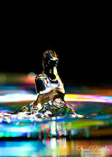 Photo: Alien water drop. A drop of water with a dvd under refracting the light creating the colors you see here. Never know what shapes you will end up with ... thought this was pretty cool looking.  Frank