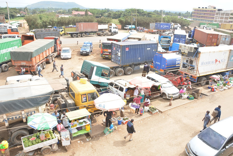 Trucks in Mai Mahiu town as drivers wait to be tested for Covid-19