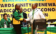 Cyril Ramaphosa shakes hands with new national chairperson Gwede Mantashe before delivering his closing address during the 54th ANC elective conference on Wednesday night.