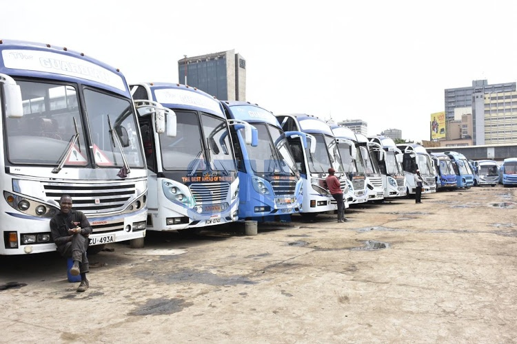 Buses parked in Nairobi after the Ministry of Health failed to issue transport companies with travel guidelines. Many people remained stranded.