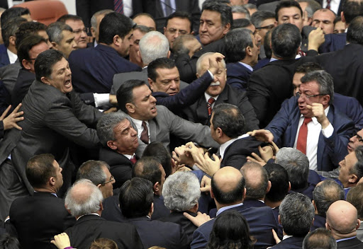 Legislators of Turkey's  ruling AK Party and the main opposition Republican People's Party scuffle in  a debate on proposed constitutional changes in the Ankara  parliament on Thursday Picture: RUTERS