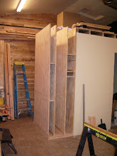 """Photo: The left side is a piece of the 1"""" flooring I had left over. I used the heavier ply here in order to better support the clamp storage that will be mounted to the outside of it... edit Delete caption"""