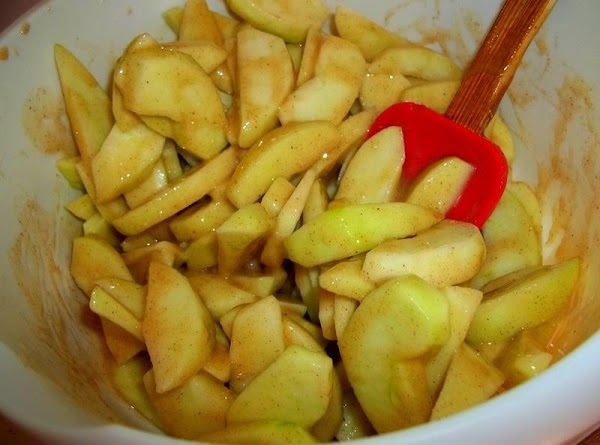 In a large bowl add sliced apples. Pour the honey mixture over the apples...