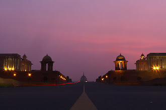 Photo: A late evening monsoon cloud catches the last light of the twilight sun in the foreground of the Presidential Palace in New Delhi. (AP)