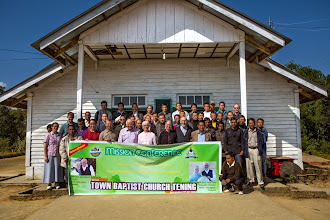 Photo: The full pastoral missions conference group in front of the church where the conference was conducted in Tening Town.