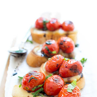 Caprese Crostini with Blistered Tomatoes and Smoked Mozzarella