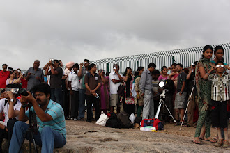 Photo: People waiting in queue for their turn at the eyepiece...