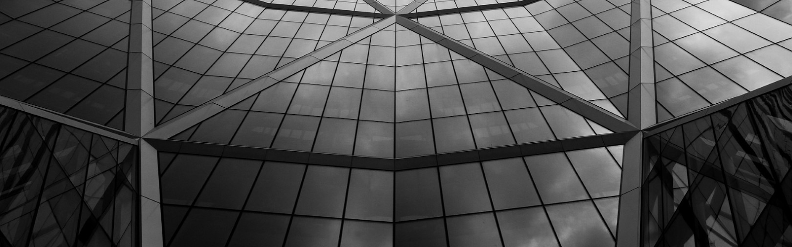 black and white of a glass building
