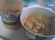 Cut leftover Chicken into pieces and put in a bowl. Add enough tostitos salas conqueso...
