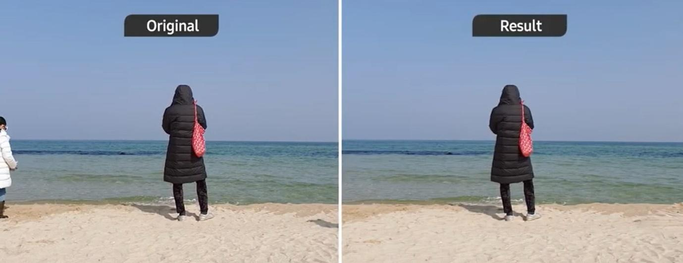 A person standing on a beach  Description automatically generated with medium confidence