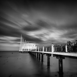 Under the cloud. by Andy Prasetyo - Black & White Buildings & Architecture ( clouds, black and white, fine art, bw, sea, architecture, beach, sky, fineart, pier, architectural, cloud, cloudy, long exposure, longexposure )