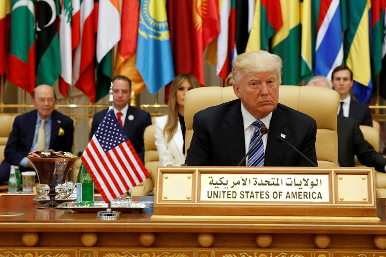 US President Donald Trump takes his seat before his speech to the Arab Islamic American Summit in Riyadh, Saudi Arabia, on May 21 2017. Picture: REUTERS