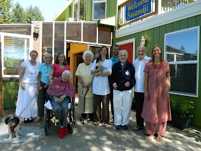 Photo: Rishi, Mari, Karen, Merry with Lynne, Gyandevi, Karuna with Tiki, Ramprashad, Joe, Hanuman, Aimee