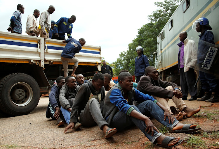 People arrested during protests wait to appear in the Magistrates court in Harare, Zimbabwe, January 16, 2019.