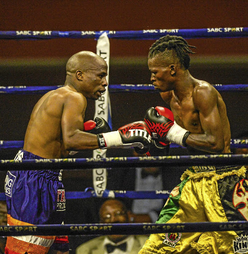 Koos Sibiya, left, on his way to win the junior lightweight division title against Bannia Mazolan in April.
