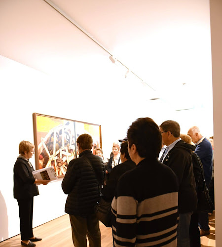 Gallery tour paticipants with volunteer Mary (2018)