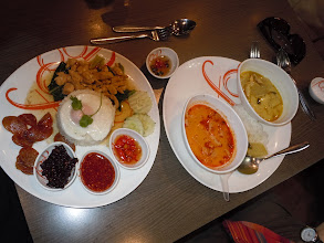 Photo: This was a brilliant meal. Plate on left has chicken, chinese sausage, rice with egg and a ground chilli paste + other sauces. Plate on right has tom yum and curry with rice.