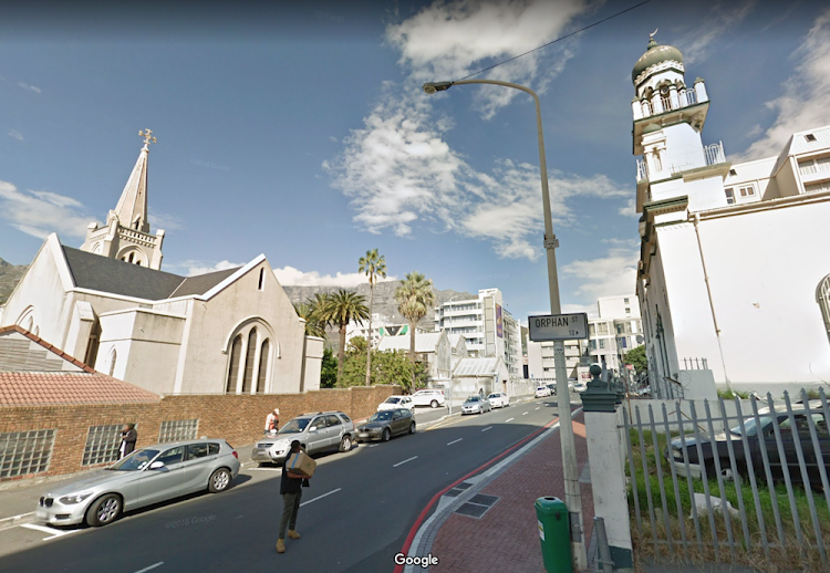 The corner of Loop and Orphan streets in Cape Town, with the Lutheran Evangelical Church on the left, and the Coowatool Mosque on the right.