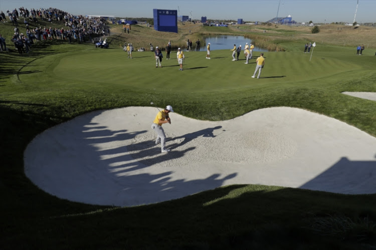Francesco Molinari of Italy and Europe plays a bunker shot by the 11th green in his final practice round ahead of the 2018 Ryder Cup at Le Golf National near Versailles on September 27th 2018 in France.