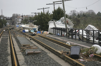 Photo: Boats from a marina lie along railroad tracks Tuesday, Oct. 30, 2012, in Point Pleasant, N.J. The boats were lifted by surging water caused by superstorm Sandy. (AP Photo/The Record, Kevin R. Wexler) MAGS OUT  TV OUT  ARCHIVE OUT  ONLINES OUT   MANDATORY CREDIT