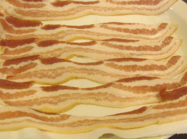 Add sliced bacon to a platter lined with paper towel, arrange bacon slices, and...