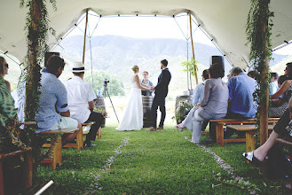 Photo: Ceremony near the pool, with mountains as the backdrop
