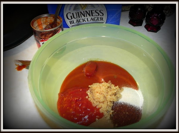 In a bowl, stir together the adobo sauce, chili powder, tomato paste, garlic and...