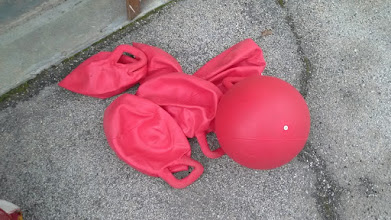 Photo: Red bouncy balls with handles