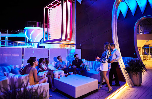 Celebrity-Edge-Pool-night.jpg - The Pool Deck, with an LED light art installation, is a stunning space that makes ocean views and landscapes the focal point.