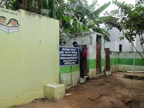 Photo: Sandeep checks out the toilet at Placepalayam.