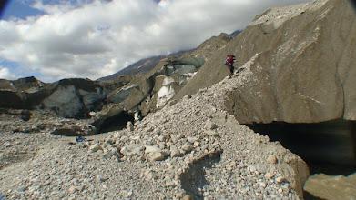 Photo: crossing glacier river by ice bridge. Walsh glacier.