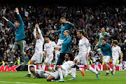 Real madrid players celebrate as they reach the final after the UEFA Champions League Semi Final Second Leg match between Real Madrid and Bayern Muenchen at the Bernabeu on May 1, 2018 in Madrid, Spain.