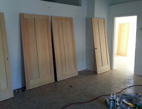 Photo: December 19, 2012 Some of the door slabs getting finished. These doors have come to be the Achilles' heel of the job, mostly due to scheduling. Florida's a moist state, even in winter, and raw wood doesn't tolerate that too well. Still, they look stunning.