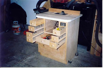 Photo: I added the center drawer below the router compartment to store shop-made bases and other parts. Since I had built the table a little taller to begin with, there was plenty of room...