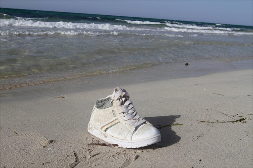 A shoe washed up on the shore are pictured near a route frequented by migrants trying to cross the Mediterranean, near the coastal town of Zuwara, west of Tripoli, Libya, June 4, 2016. REUTERS/Hani Amara