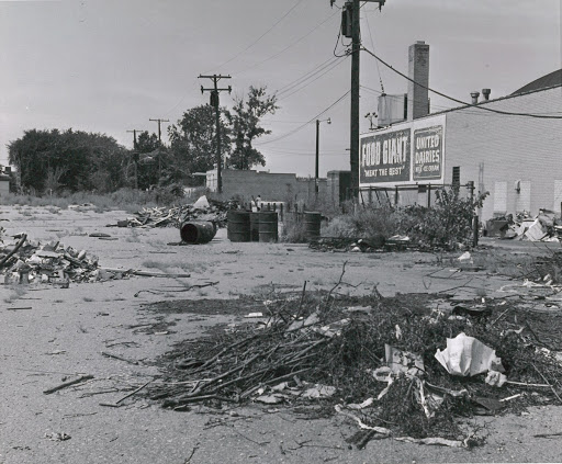 Parking Lot with Junk and Commercial Ads of 1969