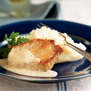 Pork Chops with Country Gravy and Mashed Potatoes.
