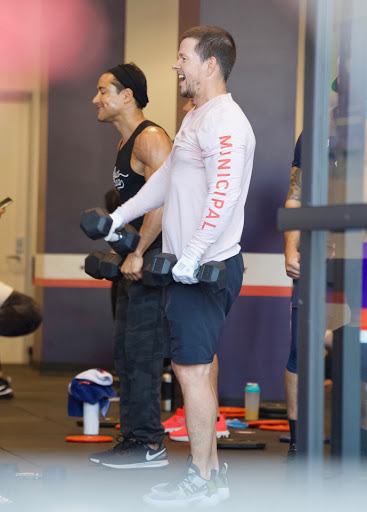Mark Wahlberg shows off slimmed-down figure during gym session with Mario Lopez after packing on pounds for film role